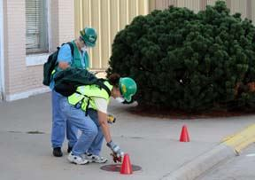 CERT Volunteers Looking at Street